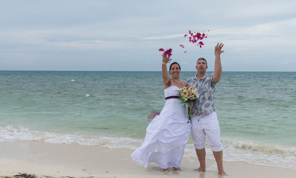 Beach wedding bride and groom flower
