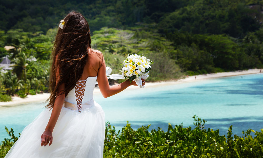 beach wedding bride with flower
